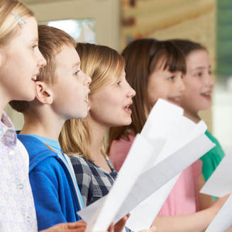 Bild vergrößern: Group Of School Children Singing In School Choir